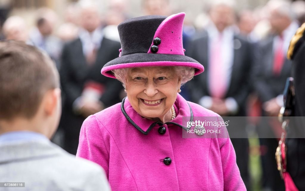 Britain's Queen Elizabeth II smiles as she hosts a ceremony to celebrate the 40th Anniversary of Motability, at Windsor Castle, west of London on April 25, 2017. Motability is a charity that enables disabled people, their families and carers to lease a new car, scooter or powered wheelchair using their mobility allowance. /