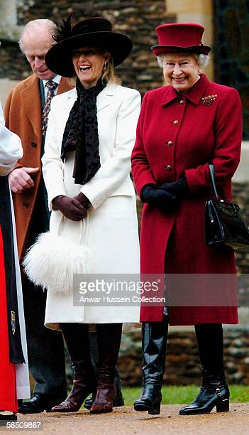 Britain's Queen Elizabeth II smiles as she leaves St Mary Magdalene Church alongside Sophie Countess of Wessex and the Duke of Edinburgh on January 1...