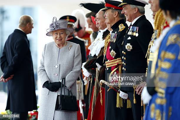 Britain's Queen Elizabeth II smiles as she waits with dignitaries for the arrival of the Chinese president at the royal pavilion on Horse Guards...