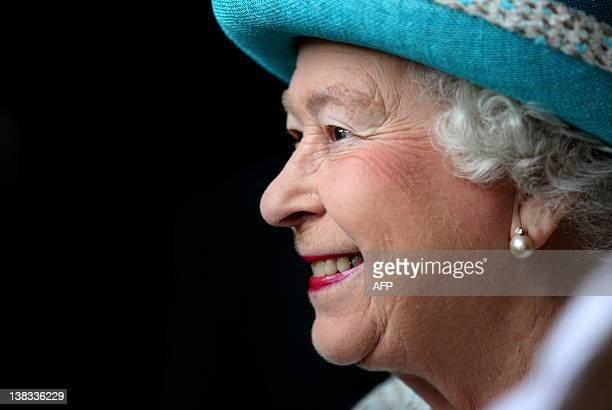 Britain's Queen Elizabeth II smiles during a vist to Kings Lynn Town Hall in Kings Lynn Norfolk on February 6 2012 to start celebrations for her...