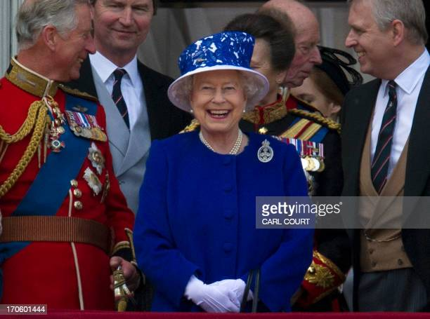 Britain's Queen Elizabeth II smiles flanked by Prince Charles Prince of Wales and Prince Andrew Duke of York ahead of the flypast on the balcony at...
