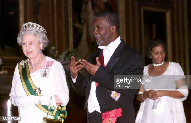 Britain's Queen Elizabeth II South African President Thabo Mbeki and his wife Zanele walk towards the state banquet in St George's Hall at Windsor...