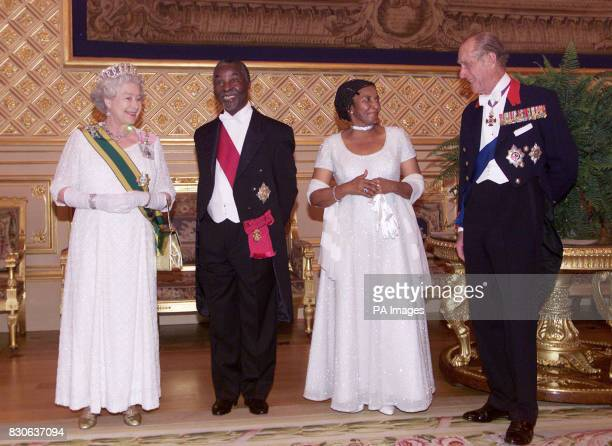 Britain's Queen Elizabeth II South African President Thabo Mbeki his wife Zanele and the Duke of Edinburgh talk as they attend the state banquet in...