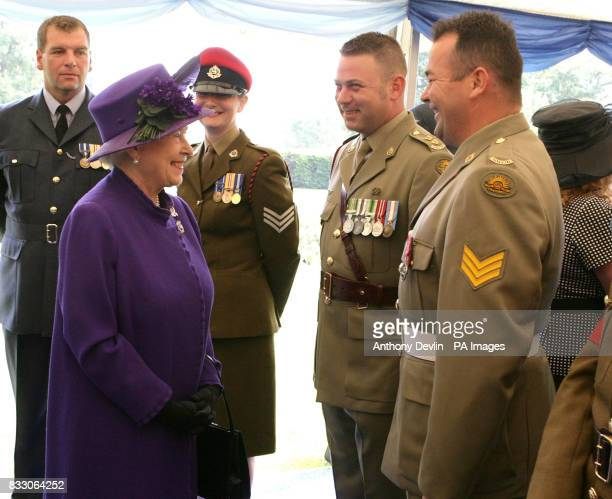 Britain's Queen Elizabeth II speaks to Lieutenant Jason Urqhart and Sergeant Timothy McNamara from the Royal Australian Corp of Military Police at a...