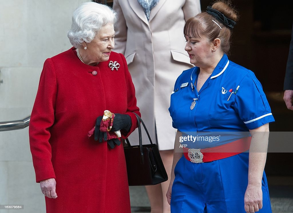 Britain's Queen Elizabeth II speaks with a member of nursing staff as she leaves King Edward VII Hospital in London on March 4, 2013 after being admitted suffering from gastroenteritis. Britain's Queen Elizabeth II left hospital after a one-night stay, having been admitted for the first time in 10 years after suffering from the symptoms of gastroenteritis. The illness forced her to call off a visit to Rome this week, which would have been her first overseas trip since October 2011. AFP PHOTO / WILL OLIVER