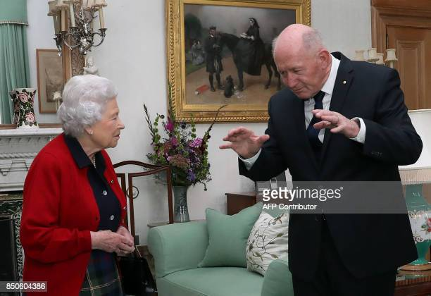Britain's Queen Elizabeth II speaks with General Sir Peter Cosgrove the GovernorGeneral of Australia during a private audience in the Drawing Room at...