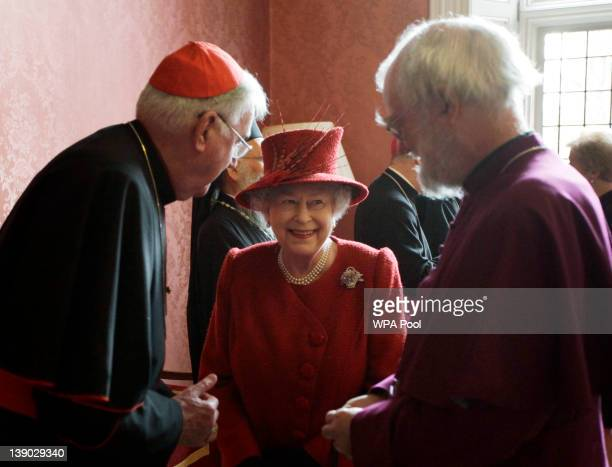 Britain's Queen Elizabeth II speaks with the Archbishop of Canterbury Rowan Williams and the Catholic Church's Cardinal Cormac MurphyO'Connor as they...