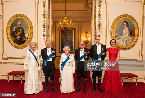 Britain's Queen Elizabeth II stands with her husband Britain's Prince Philip Duke of Edinburgh her son Britain's Prince Charles Prince of Wales and...