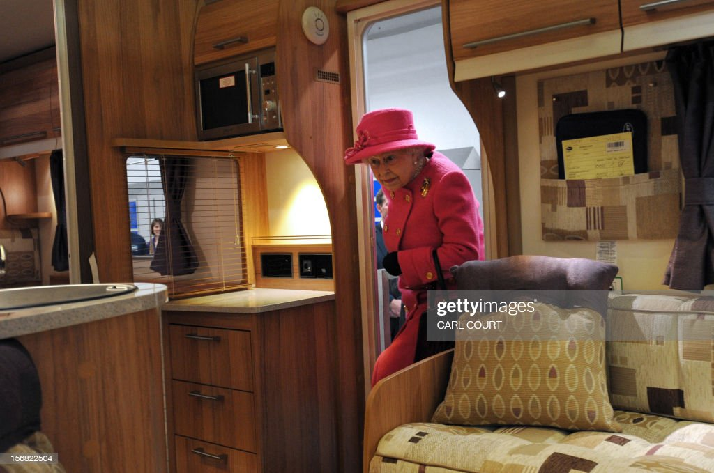 Britain's Queen Elizabeth II steps into a motorhome during a visit to the Bailey caravan factory in Bristol on November 22, 2012. AFP PHOTO / POOL/ CARL COURT