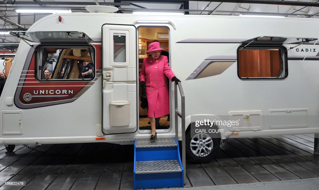 Britain's Queen Elizabeth II steps out of a motorhome during a visit to the Bailey caravan factory in Bristol on November 22, 2012. AFP PHOTO / POOL/ CARL COURT