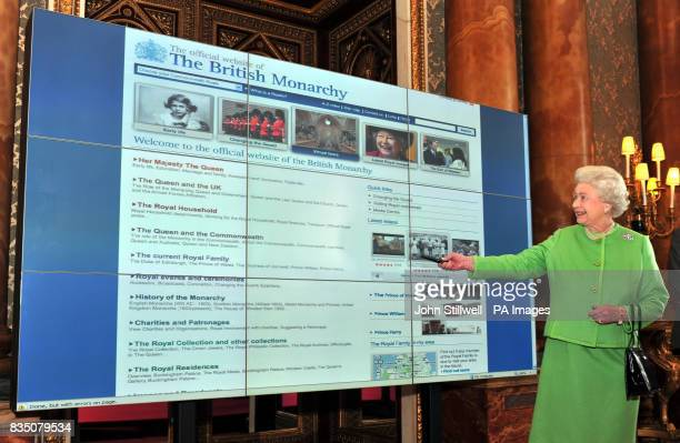 Britain's Queen Elizabeth II studies the new layout of the Monarchy Website after she relaunched the latest version of the Web favorite at Buckingham...