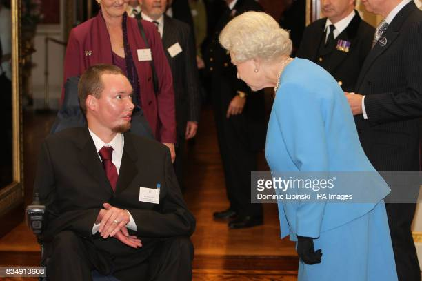 Britain's Queen Elizabeth II talks to Marcus Tripp from Sunshine Hospital Radio WestonsuperMare during a reception at Buckingham Palace in London for...