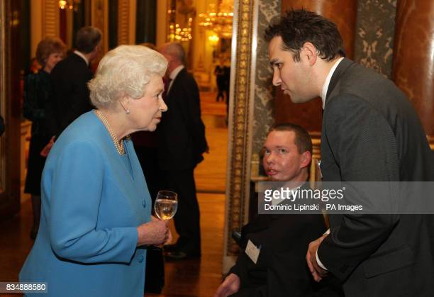 Britain's Queen Elizabeth II talks to Marcus Tripp from Sunshine Hospital Radio WestonsuperMare and Matt Wade from Hospital Radio Chelmsford during a...