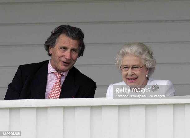 Britain's Queen Elizabeth II talks with Arnaud Bamberger Managing Director of Cartier as she watches the Queen's Cup Final at the Guards Polo Club...