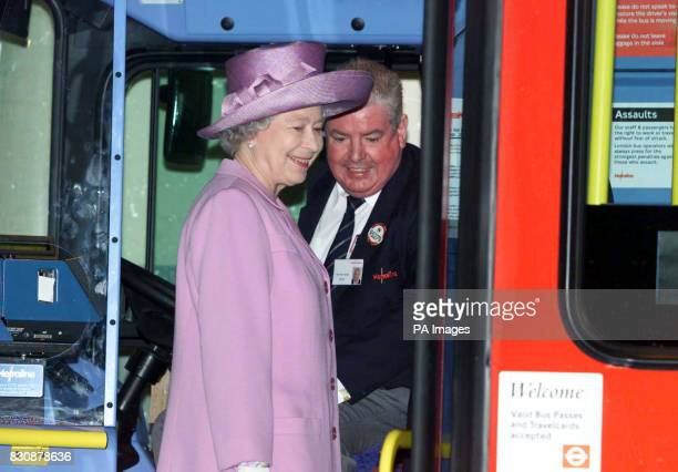 Britain's Queen Elizabeth II talks with bus driver Tony Farrell as she looks round a double decker bus in Willesden bus garage North London The Queen...