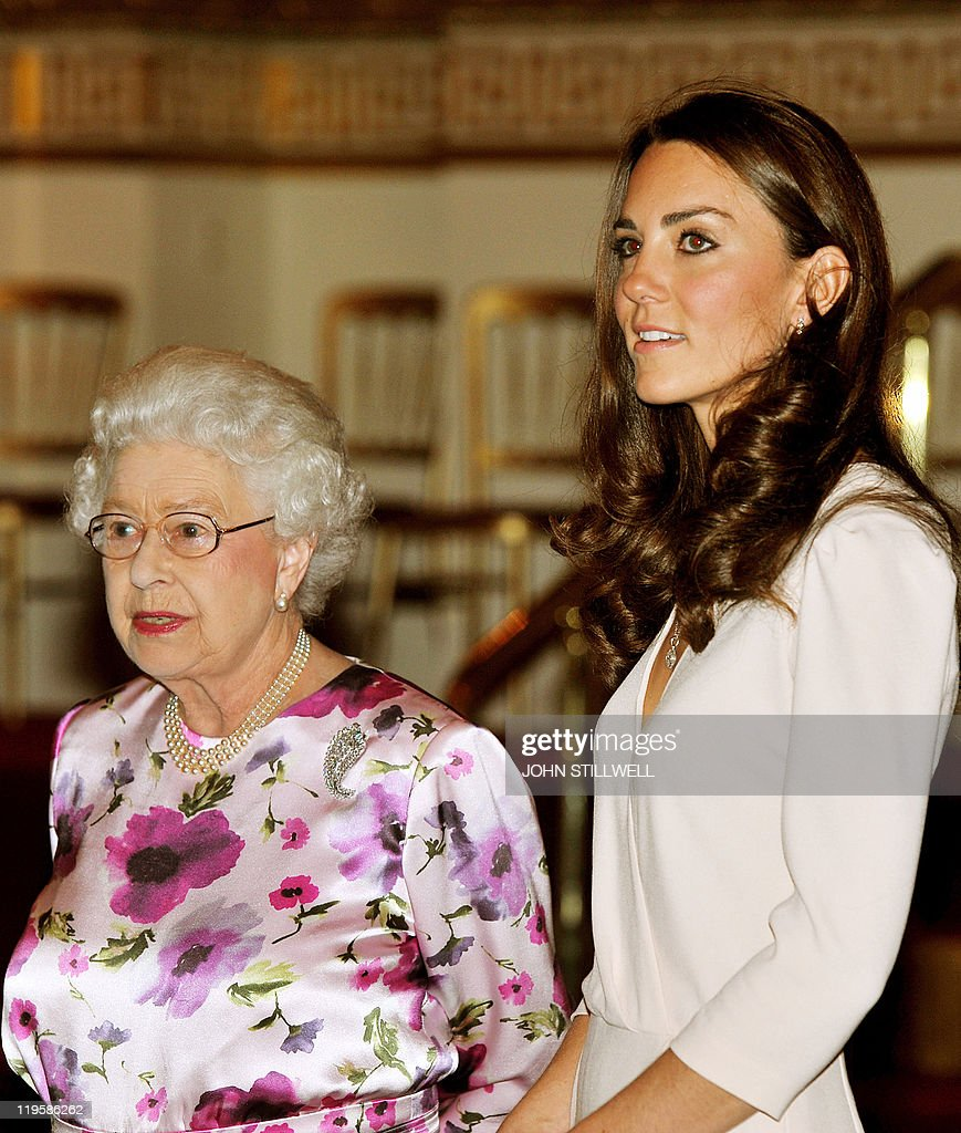 Britain's Queen Elizabeth II (L) talks with Catherine, the Duchess of Cambridge as they view the dress she wore for her royal wedding to Britain's Prince William at the annual summer exhibition at Buckingham Palace in central London, on July 22, 2011. Britain's Queen Elizabeth II has reportedly described as 'creepy' a new exhibition featuring the wedding dress worn by the former Kate Middleton when she married Prince William in April. The Alexander McQueen dress is being exhibited on a headless mannequin in the ballroom at Buckingham Palace, with the tiara and veil that the now Duchess of Cambridge wore, suspended above it.