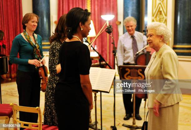 Britain's Queen Elizabeth II talks with Condoleezza Rice the US Secretary of State with Louise Miliband the wife of Foreign Secretary David Miliband...