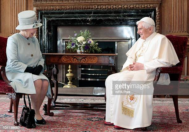 Britain's Queen Elizabeth II talks with Pope Benedict XVI during an audience in the Morning Drawing Room at the Palace of Holyroodhouse on day one of...
