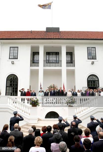 Britain's Queen Elizabeth II the Duke of Edinburgh Turkish Prime Minister Tayyip Erdogan and his wife Emine Erdogan listen to the national anthems...