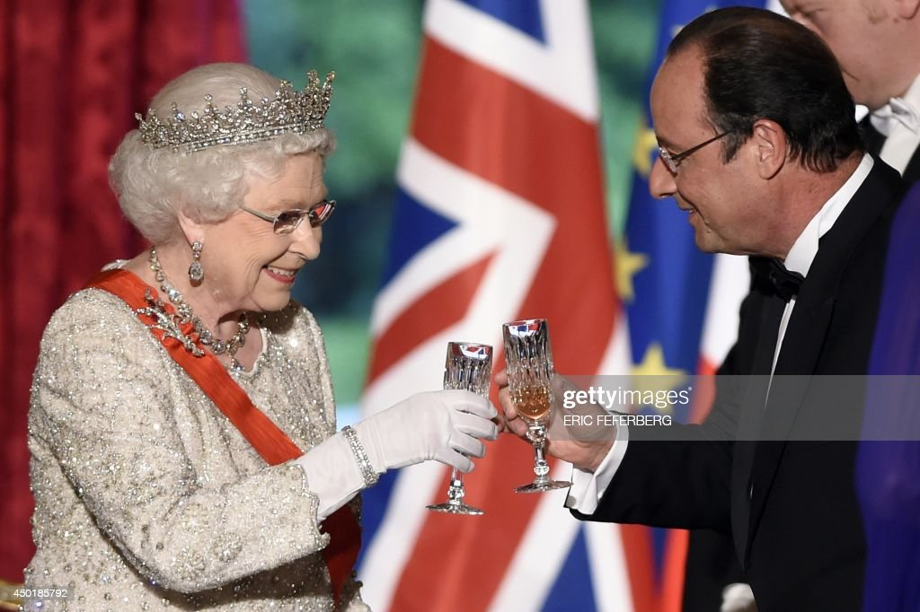 Britain's Queen <a gi-track='captionPersonalityLinkClicked' href=/galleries/search?phrase=Elizabeth+II&family=editorial&specificpeople=67226 ng-click='$event.stopPropagation()'>Elizabeth II</a> toasts with French President Francois Hollande at a state dinner at the Elysee presidential palace in Paris, following the international D-Day commemoration ceremonies in Normandy, marking the 70th anniversary of the World War II Allied landings in Normandy.