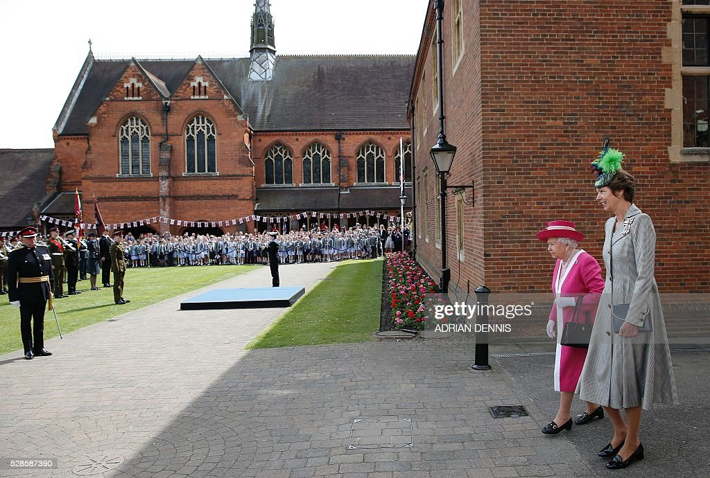 Britain's Queen Elizabeth II (2R) tours Berkhamsted School, north-west of London on May 6, 2016, on the 475th Anniversary of its foundation. The Queen, in her role as Patron of the school, will inspect a Guard of Honour formed from the school's Combined Cadet Force, and view displays celebrating various aspects of school life. Berkhamsted School was founded in 1541 by John Incent, Dean of St Paul's, initially as a school of just 144 pupils. Berkhamsted Schools Group is currently responsible for the education of over 1,800 pupils. / AFP / ADRIAN