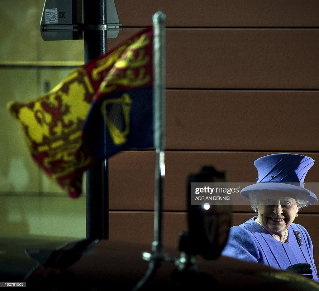 Britain's Queen Elizabeth II turns to see well-wishers as she arrives for a visit to the new Royal London Hospital building and the new National Centre for Bowel Research and Surgical Innovation in London on February 27, 2013. The Queen accompanied by the Duke of Edinburgh toured the new Royal London Hospital building, visiting the new Children's Services area meeting patients and staff. They also visited the new National Centre for Bowel Research and Surgical Innovation where they toured state-of-the-art laboratories dedicated to the study of human tissue.