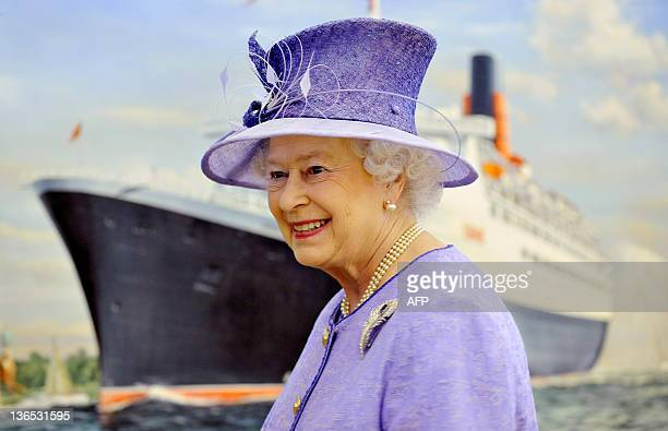 Britain's Queen Elizabeth II unveils a painting of the QE2 passing through Southampton waters by Isle of Wight artist Robert Lloyd during her visit...