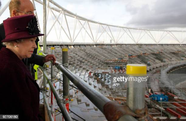 Britain's Queen Elizabeth II views the main Olympic stadium construction site during her visit to the London 2012 Olympic Park site in Stratford in...