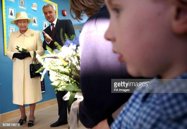 Britain's Queen Elizabeth II visiting Keys Meadow Primary school a new primary school for more than 400 pupils in Enfield Lock with headmaster...