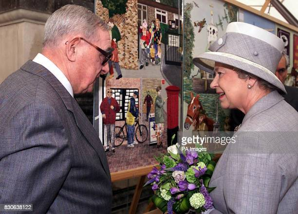 Britain's Queen Elizabeth II visiting the Sunbury Millennium Embroidery in the walled garden Sunbury on Thames Middlesex with Albert Skinner who...