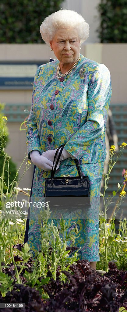 Britain's Queen Elizabeth II visits a garden during the Press & VIP preview at The Chelsea Flower Show at Royal Hospital Chelsea on May 24, 2010 in London, England. The show, which has 600 exhibitors, opens to the public on Tuesday May 25.