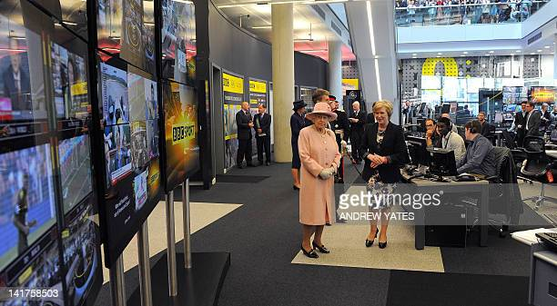 Britain's Queen Elizabeth II visits the BBC sport offices at MediaCity in Salford Greater Manchester northwest England on March 23 2012 The Queen and...