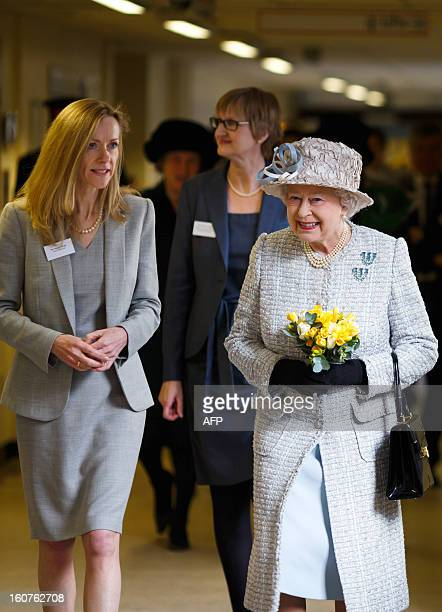 Britain's Queen Elizabeth II visits the Queen Elizabeth Hospital in King's Lynn Norfolk east England on February 5 where she opened the new MRI unit...