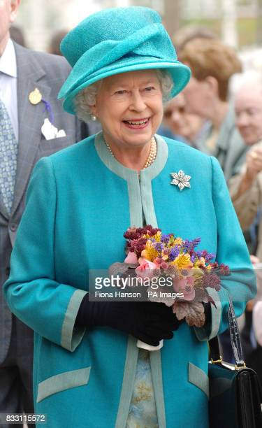 Britain's Queen Elizabeth II visits the Royal Horticultural Society Garden at Wisley Surrey where she officially opened The Glasshouse in celebration...