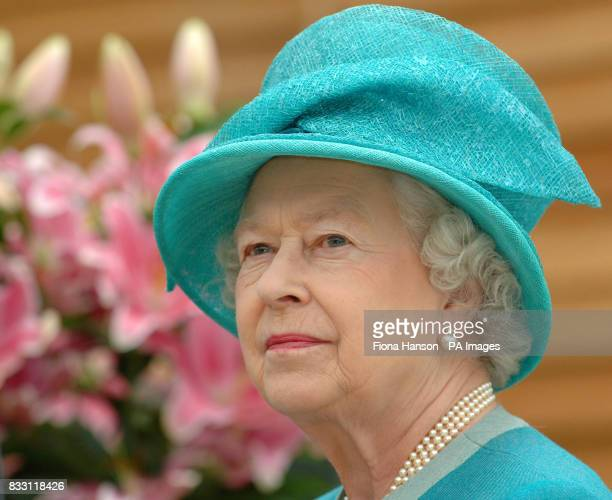 Britain's Queen Elizabeth II visits the Royal Horticultural Society Garden at Wisley Surrey to officially open The Glasshouse in celebration of the...