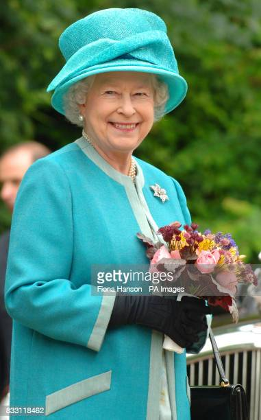 Britain's Queen Elizabeth II visits the Royal Horticultural Society Garden at Wisley Surrey wher she officially opened The Glasshouse in celebration...