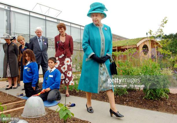 Britain's Queen Elizabeth II walks around the new Clore Learning Centre and Teaching Garden during her visit to the Royal Horticultural Society...