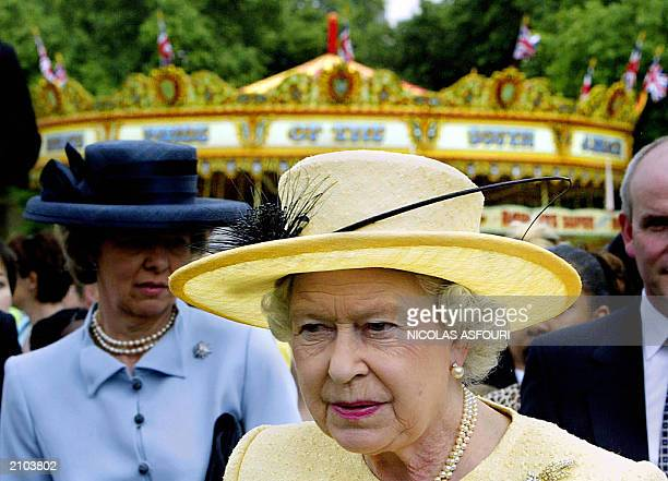 Britain's Queen Elizabeth II walks in her garden to greet some of the 500 invited children from Forces Help and the London taxi driver's fund for...