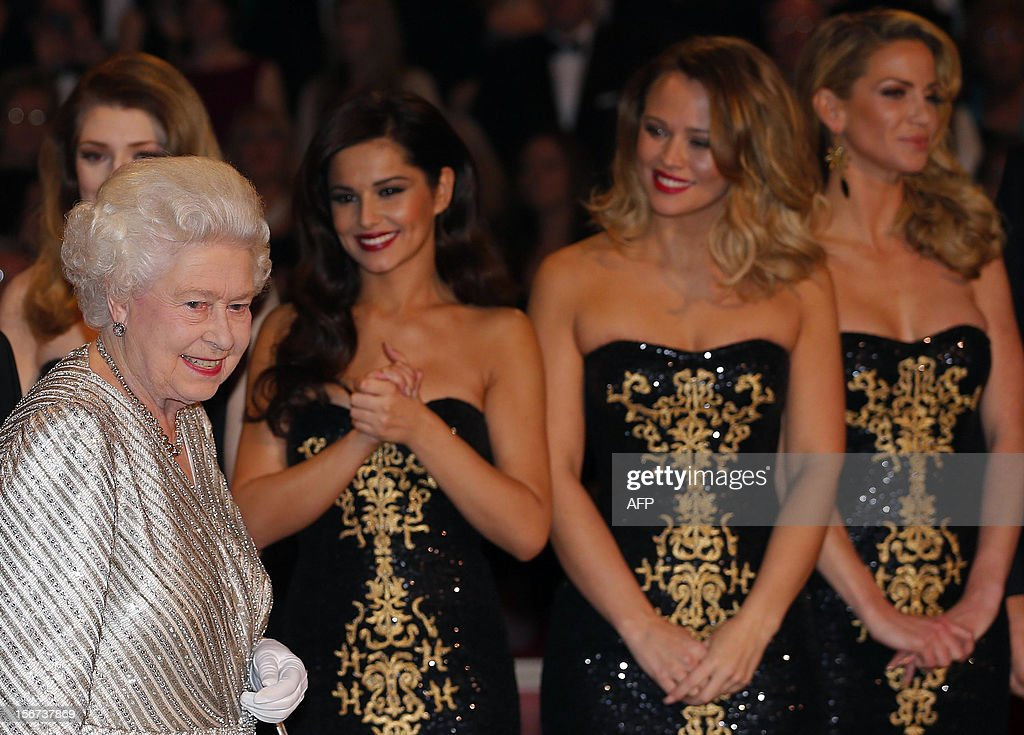 Britain's Queen Elizabeth II walks past members of British-Irish pop band Girls Aloud after the Royal Variety Performance at the Royal Albert Hall in London on November 19, 2012. The Queen, accompanied by The Duke of Edinburgh, attended the Royal Variety Performance in the show's 100th anniversary year where she met with stars of the show including Kylie Minogue, tenor Andrea Bocelli and the performing dog Pudsey.