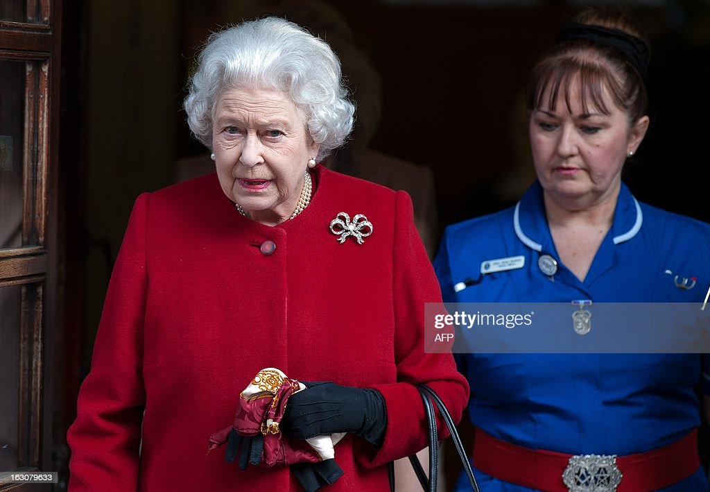 Britain's Queen Elizabeth II walks with a member of nursing staff as she leaves King Edward VII Hospital in London on March 4, 2013 after being admitted suffering from gastroenteritis. Britain's Queen Elizabeth II left hospital after a one-night stay, having been admitted for the first time in 10 years after suffering from the symptoms of gastroenteritis. The illness forced her to call off a visit to Rome this week, which would have been her first overseas trip since October 2011.
