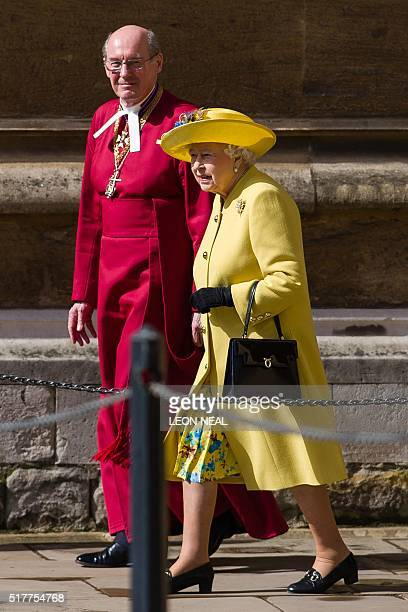Britain's Queen Elizabeth II walks with Dean of Windsor David Conner as she leaves after the Easter Sunday church service at St George's Chapel...