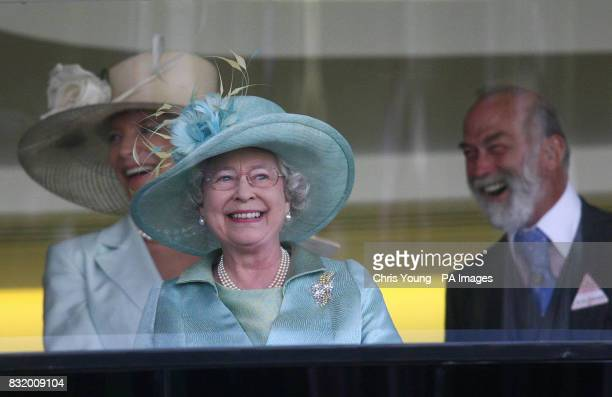 Britain's Queen Elizabeth II watches Ouija Board win the Prince of Wales Stakes with Prince and Princess Michael of Kent on the second day of racing...