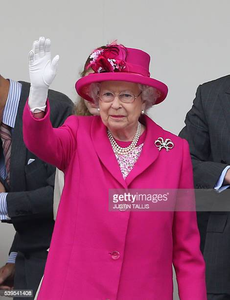 Britain's Queen Elizabeth II waves after the Patron's Lunch as hundred's of guests from organisations with which the queen has links gathered for a...