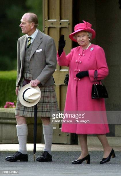 Britain's Queen Elizabeth II waves as she departs with the Duke of Edinburgh from the lawn of Balmoral castle The Queen was presented to her guests...