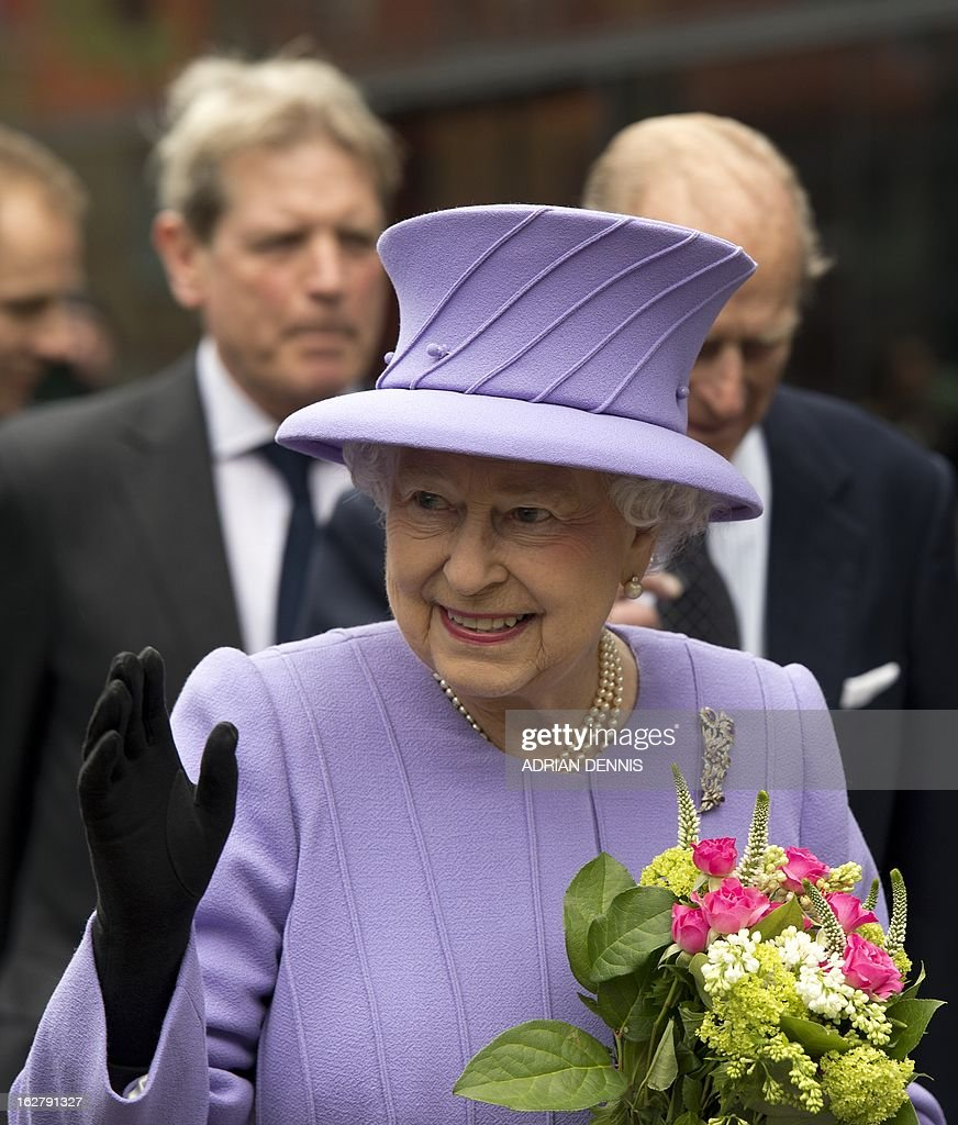 Britain's Queen Elizabeth II waves to well-wishers following a visit to the new Royal London Hospital building and the new National Centre for Bowel Research and Surgical Innovation in London on February 27, 2013. The Queen accompanied by the Duke of Edinburgh toured the building, visiting the new Children's Services area meeting patients and staff. They also visited the new National Centre for Bowel Research and Surgical Innovation where they toured state-of-the-art laboratories dedicated to the study of human tissue.