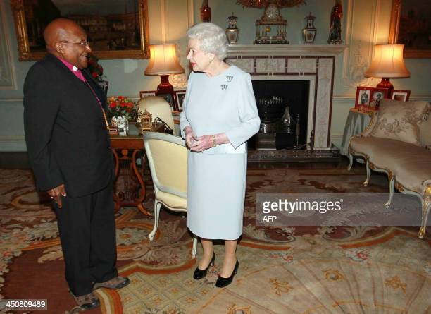 Britain's Queen Elizabeth II welcomes South African Reverend Desmond Tutu at Buckingham Palace in central London on November 20 2013 AFP...