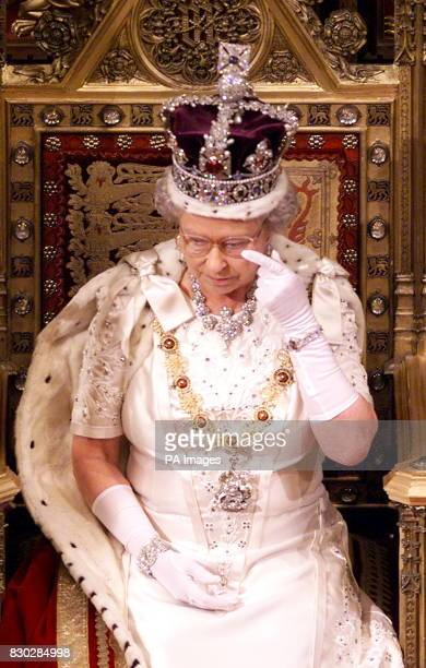 Britain's Queen Elizabeth II wipes her eye following her speech at the State Opening of Parliament in the House of Lords The Queen made her opening...
