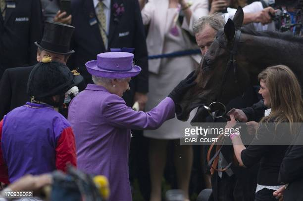 Britain's Queen Elizabeth II with her horse Estimate in the winner's enclosure after it wins the Gold Cup on the third day of Royal Ascot in...