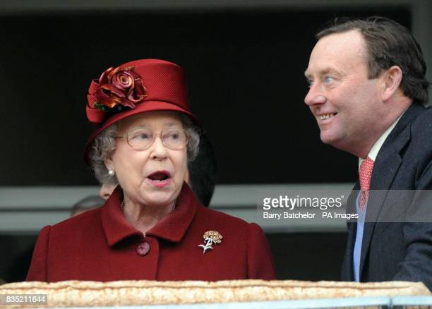 Britain's Queen Elizabeth II with Nicky Henderson the trainer of her horse Barbers Shop during the running of the Totesport Cheltenham Gold Cup...