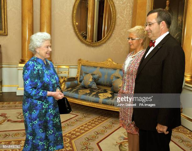 Britain's Queen Elizabeth II with the President of Estonia Mr Toomas Hendrik Ilves and his wife Evelin at Buckingham Palace London